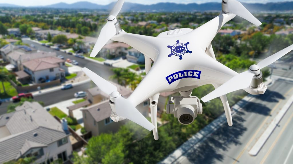 Police drone flying over city