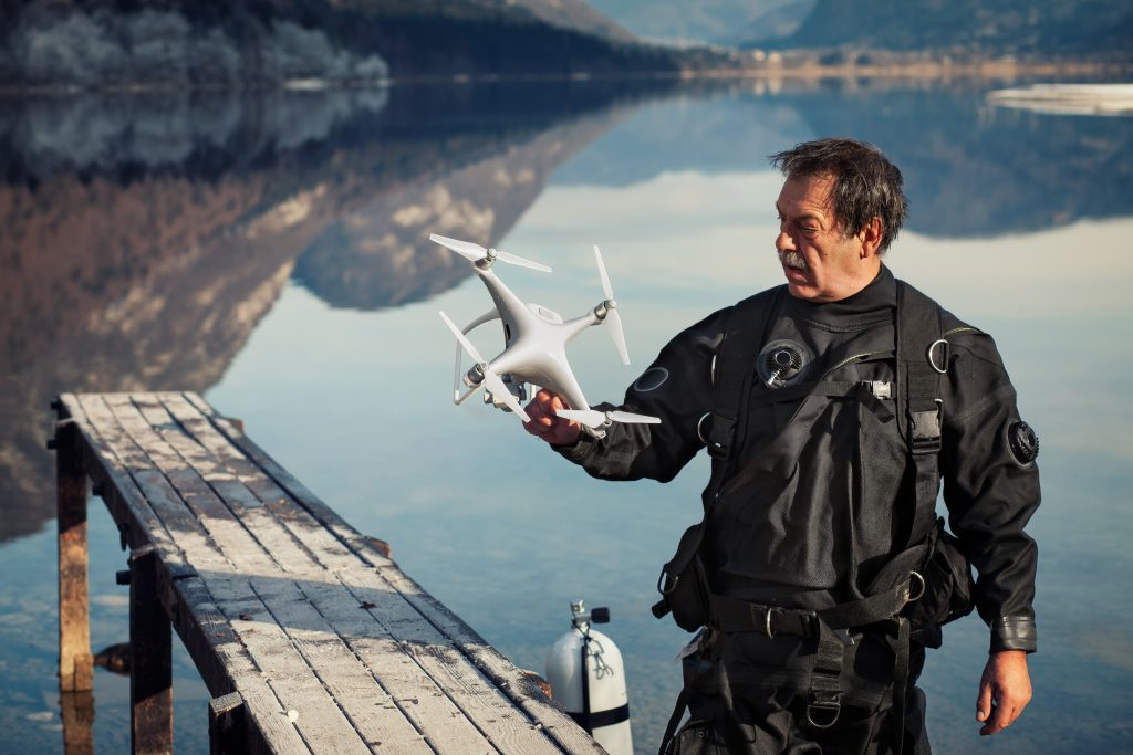 A person looking at his white phantom drone