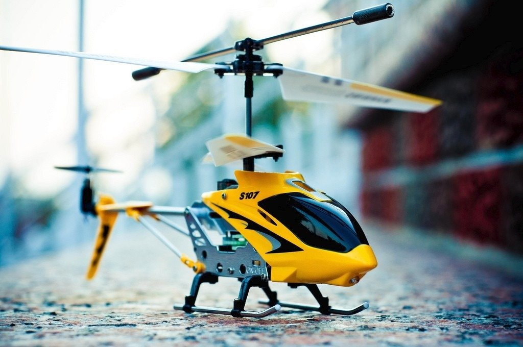 A yellow color Syma 107 G RC Helicopter.