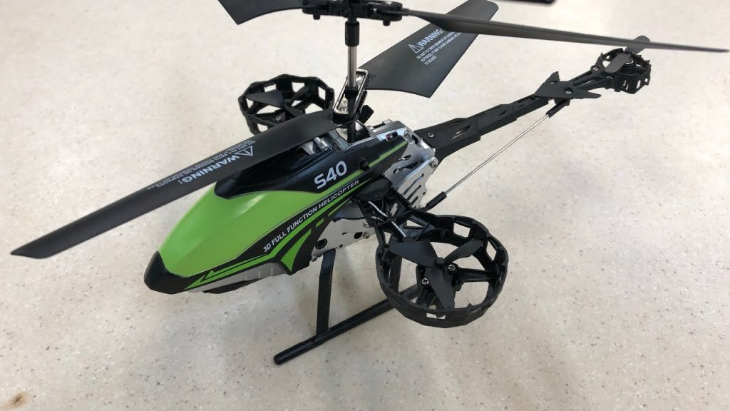 A green color Syma s40 helicopter drone