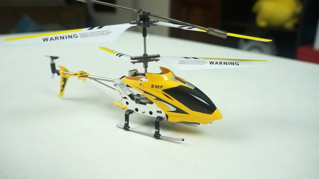 A yellow color Syma X107G drone helicopter