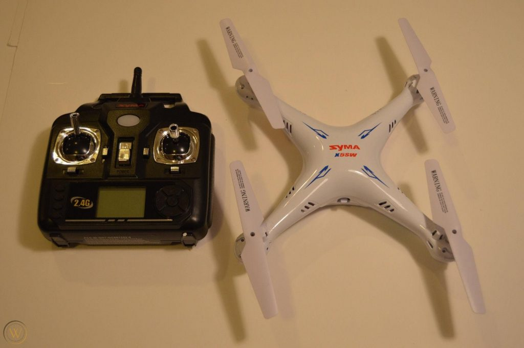 Syma x5sw-v3 drone with its controller