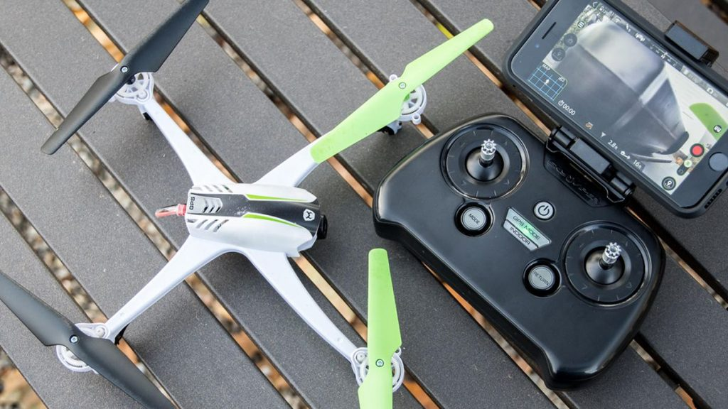 A white color toy drone with its controller