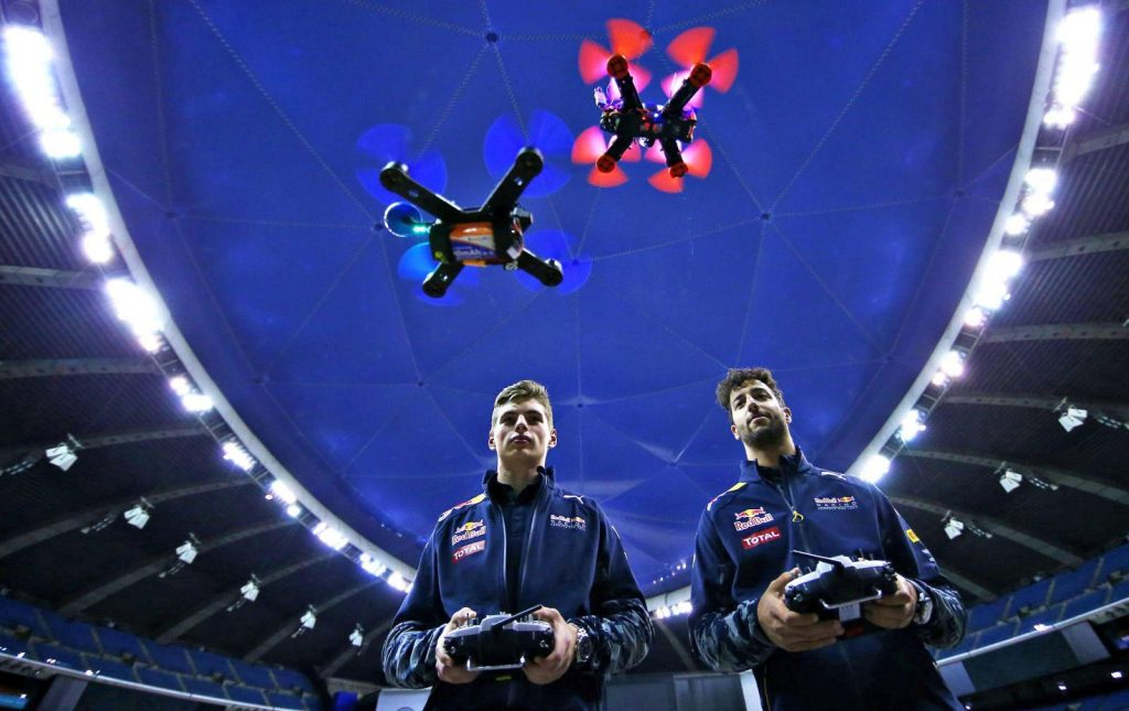 Two drone pilots flying their drone.