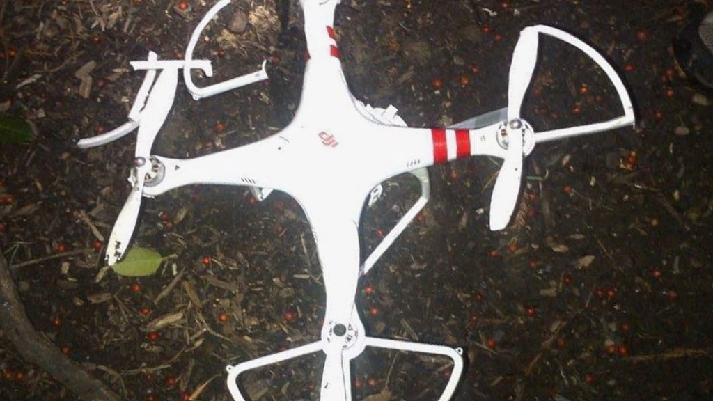A white colored drone crashed on the ground