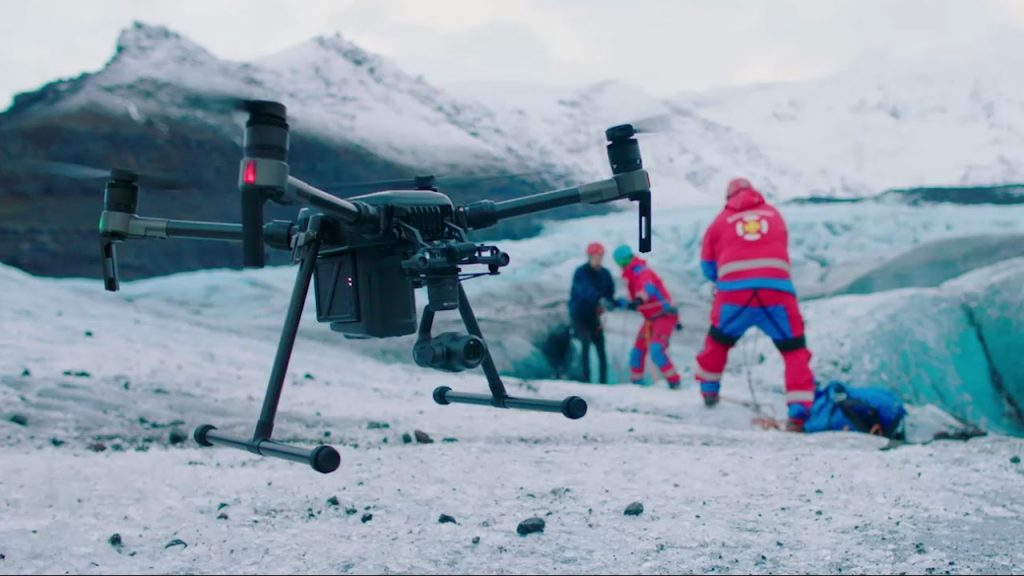 Drone flying above the mountain with snow