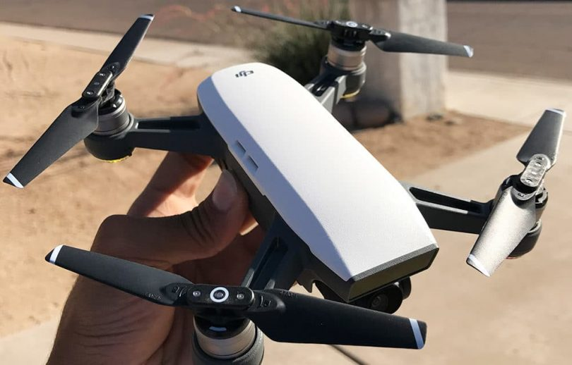A person holding a DJI Spark drone.