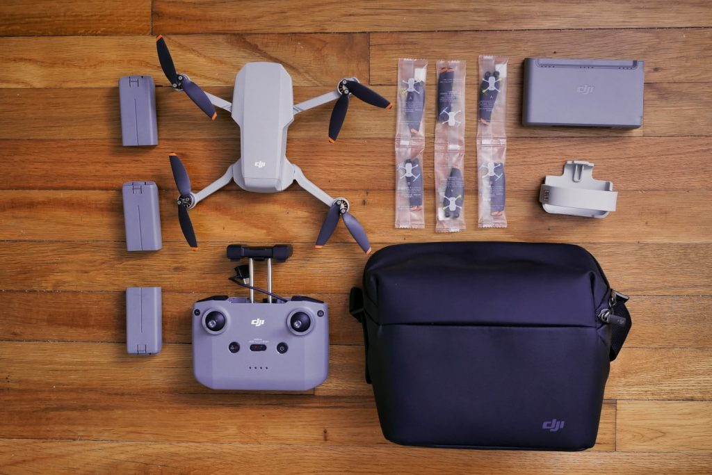 DJI MINI 2 Fly More Combo on the table.